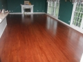 Red oak floor stained to resemble Brazilian Cherry